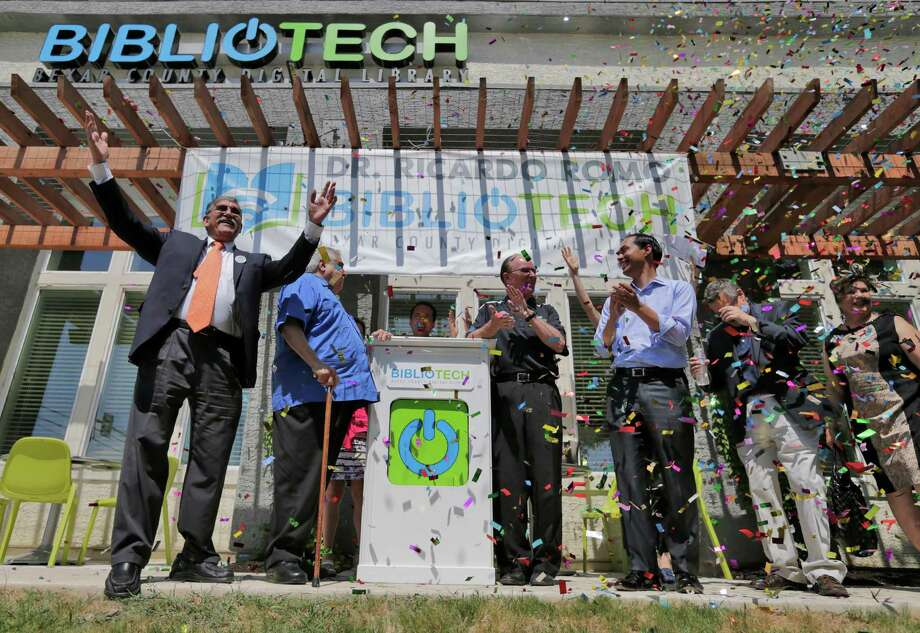 UTSA President Ricardo Romo (from left), Bexar County Commissioner Paul Elizondo, County Judge Nelson Wolff, HUD Secretary Julián Castro and other dignitaries celebrate the opening of the county's second BiblioTech, named for Romo, at the Gardens of San Juan, a San Antonio Housing Authority community. Photo: Kin Man Hui /San Antonio Express-News / ©2015 San Antonio Express-News