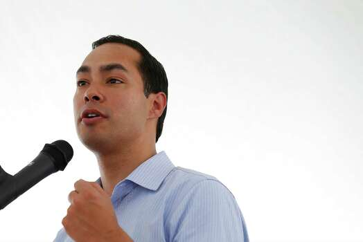 HUD Secretary Julian Castro addresses an audience during the celebration of the opening of the second Bibliotech named after UTSA President Ricardo Romo at the Gardens of San Juan Square - a San Antonio Housing Authority Community - on Saturday, July 25, 2015. The nation's first all-digital public library, Bibliotech added a second branch in the public housing development located on the city's westside. Romo grew up on the Westside and was honored by having his name emblazoned on the library. Bibliotech gives Bexar County residents access to 38,000 titles which can be accessed via all digital devices and computers. Book titles can also be checked out on e-readers for a two-week period. Gardens of San Juan Square is SAHA's newest mixed-income community that has 539 units. There are currently more than 65,000 registered users of the digital library and over 181,000 on-site visitors to the first location on Pleasanton Road. (Kin Man Hui/San Antonio Express-News) Photo: Kin Man Hui, Staff / San Antonio Express-News / ©2015 San Antonio Express-News
