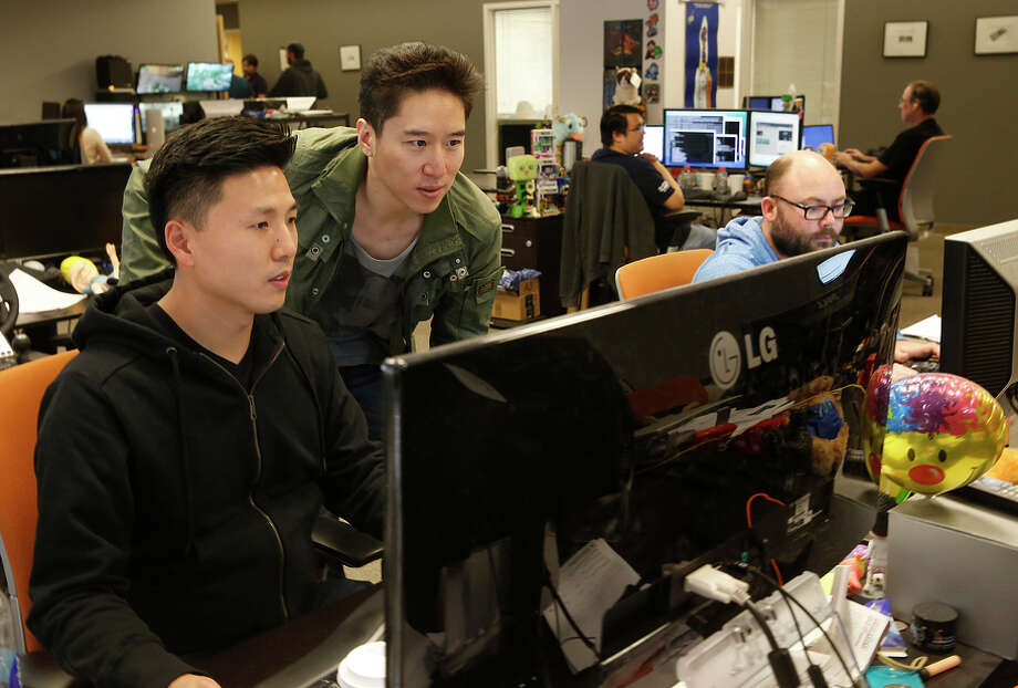 "Left: Patrick Li (left) works with found er and CEO Dennis ""Thresh"" Fong (center) at the gaming social net work Raptr. Photo: Liz Hafalia / Liz Hafalia / The Chronicle / ONLINE_YES"
