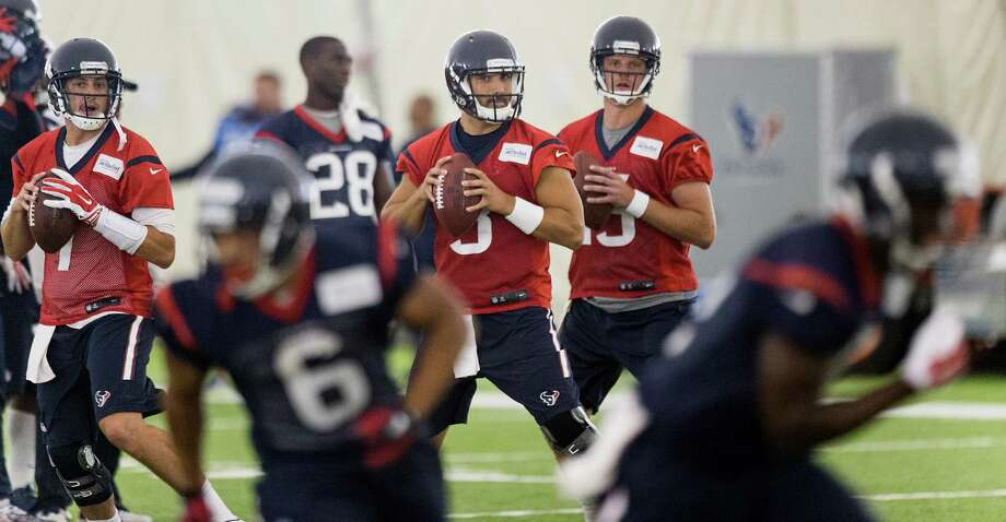 Quarterbacks Brian Hoyer, from left, Tom Savage and Ryan Mallett will take their best shots at earning playing time as the Texans' preseason unfolds. Photo: Brett Coomer, Staff / © 2015 Houston Chronicle