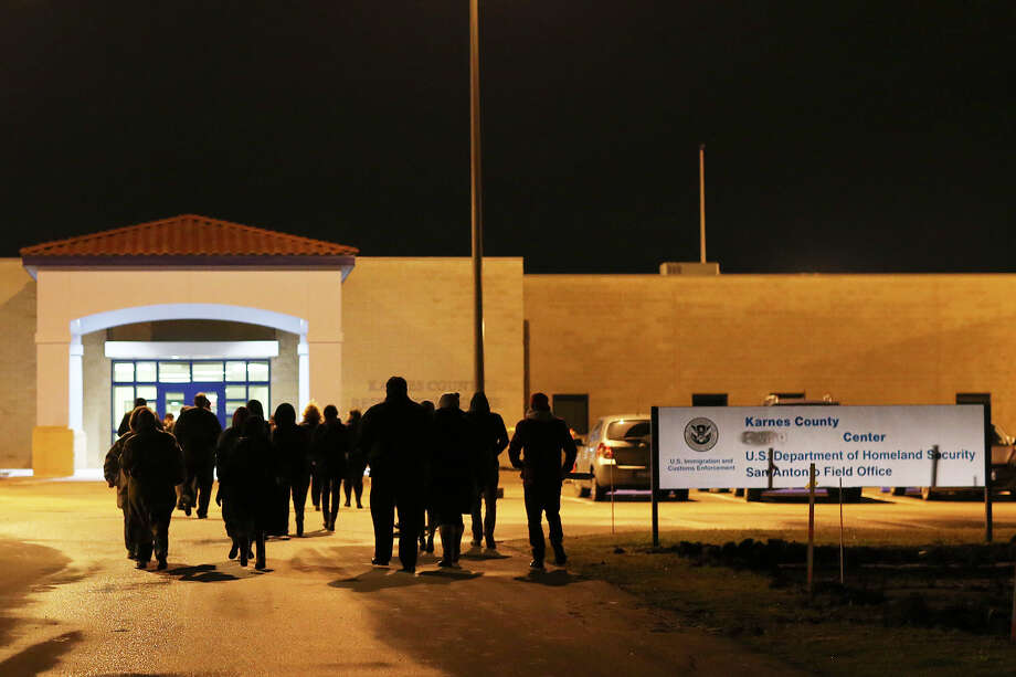 Members of rights groups UltraViolet and GetEQUALwalk toward the detention facility for immigrants in Karnes County in January to deliver petitions calling for the closure of the center. This center and another in Dilley together hold more than 2,000 women and children. Photo: Jerry Lara /San Antonio Express-News / © 2015 San Antonio Express-News