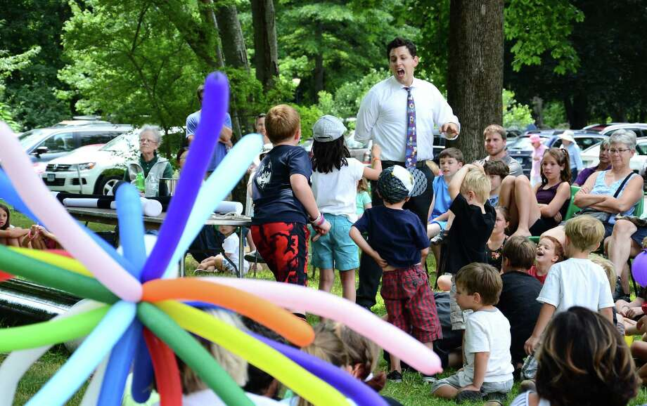 Magician Ben Nemzer entertains a group of children during a show at the 109th Nutmeg Festival at St. Stephen's Episcopal Church in Ridgefield, Conn., on Saturday afternoon, July 25, 2015. Photo: Nelson Oliveira / Nelson Oliveira / New Canaan News