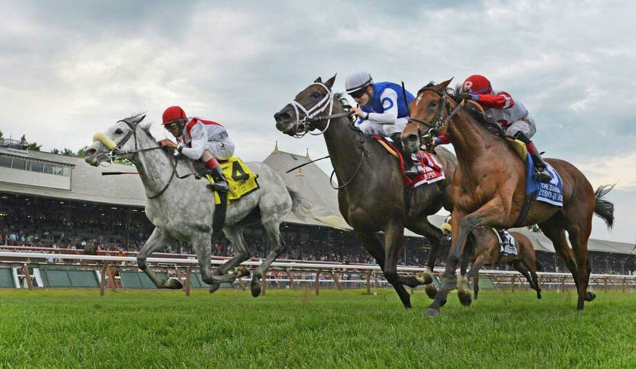 #4 Hard Not To Like with jockey John Velazquez, left squeaks by on the outside to win the 77th running of The Diana Stakes at the Saratoga Race Course this afternoon July 25, 2015 in Saratoga Springs, N.Y.  (Skip Dickstein/Times Union) Photo: SKIP DICKSTEIN