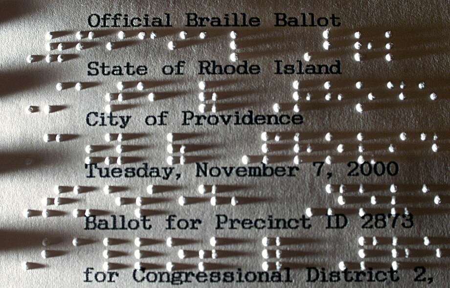 President Donald Trump in the early 1980s asked an architect to remove braille from planned residential elevators in Trump Tower in New York, saying blind people would not live there. This Thursday, Nov. 2, 2000 file photo shows an official Rhode Island braille ballot at a statehouse office in Providence. Photo: Victoria Arocho, STF / AP