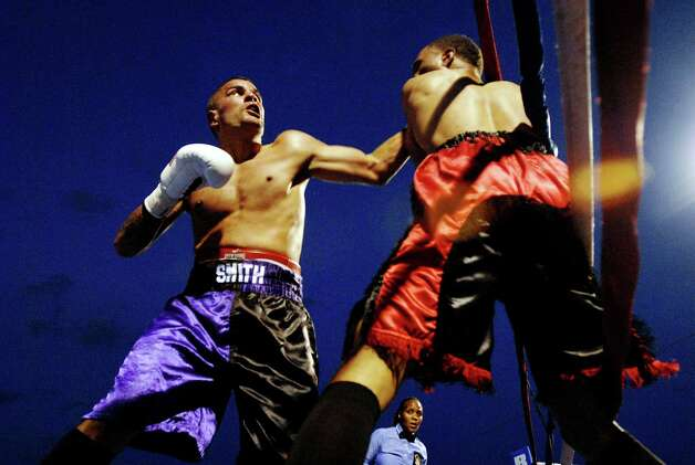 Zach Smith of Delmar, left, has opponent Laquan Lewis against the ropes during their lightweight bout on Friday, Aug. 7, 2009, at Joe Bruno Stadium in Troy, N.Y. Smith wins the bout. (Cindy Schultz / Times Union) Photo: CINDY SCHULTZ / 00005026A