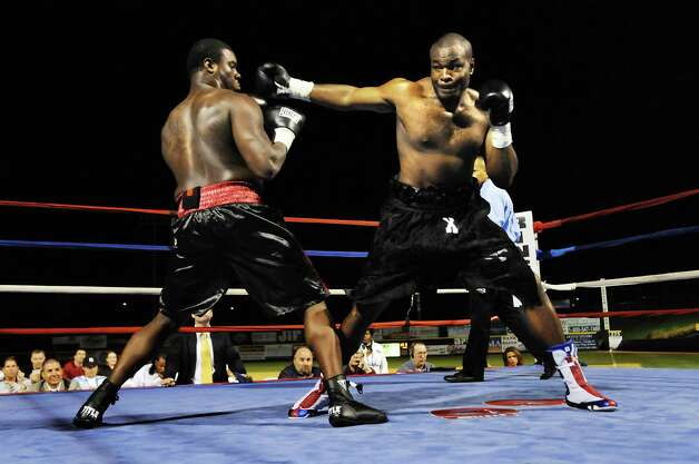 In his pro debut, heavyweight Kimdo Bethal, right,  fights James Rankin, left, and knocks him out Friday, Aug. 7, 2009, at Joe Bruno Stadium in Troy, N.Y. (Cindy Schultz / Times Union) Photo: CINDY SCHULTZ / 00005026A