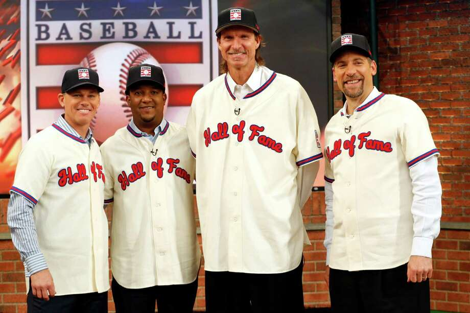 In this Jan. 7, 2015, file photo, members of the National Baseball Hall of Fame 2015 inductee class, from left, Craig Biggio, Pedro Martinez, Randy Johnson and John Smoltz pose for photographers at the MLB Network's Studio 42 in Secaucus, N.J. All four will be inducted Sunday, July 26, 2015, in Cooperstown. (AP Photo/Julio Cortez) Photo: Julio Cortez / AP