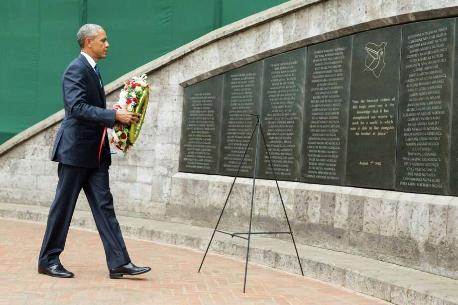 President Barack Obama participates in a wreath laying ceremony Saturday, in Nairobi, at Memorial Park in honor of the victims of the deadly 1998 bombing at the U.S. Embassy.   Photo: Evan Vucci, STF / AP
