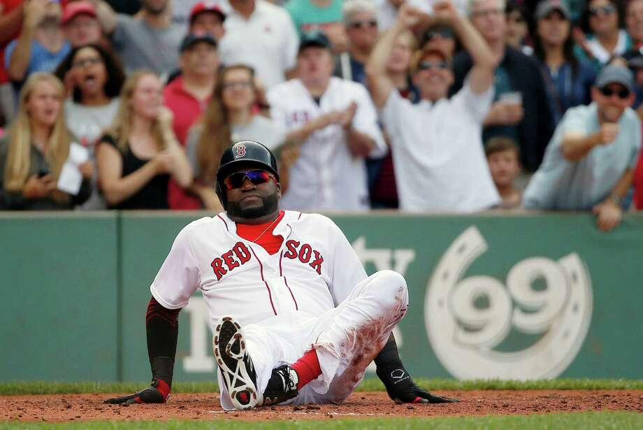Boston Red Sox's David Ortiz sits on the ground after being tagged out at home plate trying to score on a single by Hanley Ramirez during the second inning of a baseball game against the Detroit Tigers in Boston, Saturday, July 25, 2015. (AP Photo/Michael Dwyer) ORG XMIT: MAMD106 Photo: Michael Dwyer / AP