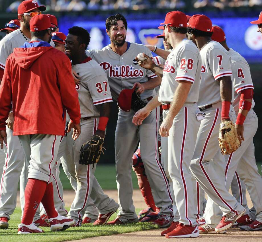 Philadelphia ace lefthander Cole Hamels, center, is handed the last ball he pitched after tossing a no-hitter Saturday afternoon against the Chicago Cubs. It was the 13th no-hitter in Phillies history. Photo: Matt Marton, FRE / FR170980 AP