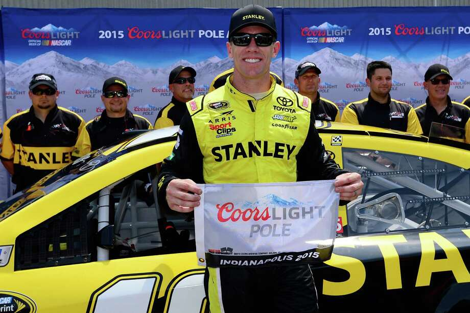INDIANAPOLIS, IN - JULY 25:  Carl Edwards, driver of the #19 Stanley Toyota, poses with the Coors Light Pole Award after qualifying for the pole position for the NASCAR Sprint Cup Series Crown Royal Presents the Jeff Kyle 400 at the Brickyard at Indianapolis Motor Speedway on July 25, 2015 in Indianapolis, Indiana.  (Photo by Robert Laberge/Getty Images) ORG XMIT: 566420645 Photo: Robert Laberge / 2015 Getty Images