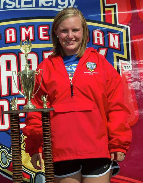 Kelsey Settles of Owensboro, Ky., stands with her trophy on the awards stand after winning the Rally Masters Division at the All-American Soap Box Derby in Akron, Ohio,  Saturday, July 25, 2015. (AP Photo/Phil Long) Photo: Phil Long, FRE / FR53611 AP