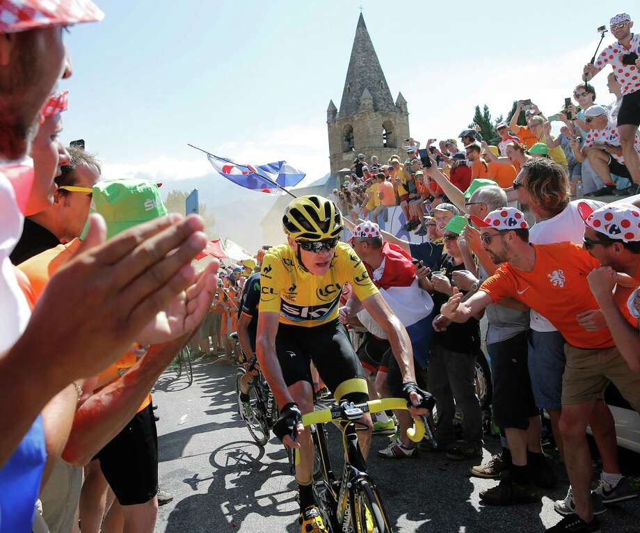 Britain's Chris Froome, wearing the overall leader's yellow jersey, climbs towards Alpe d'Huez during the twentieth stage of the Tour de France cycling race over 110.5 kilometers (68.7 miles) with start in Modane and finish in Alpe d'Huez, France, Saturday, July 25, 2015. (AP Photo/Laurent Cipriani) ORG XMIT: PDJ105 Photo: Laurent Cipriani / AP