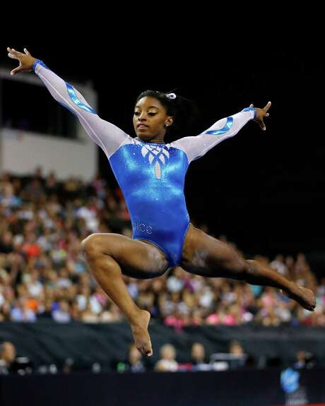 Simone Biles shows off her form in the floor exercise Saturday during the Secret U.S. Classic in Hoffman Estates, Ill. Photo: Andrew Nelles, FRE / FR170974 AP