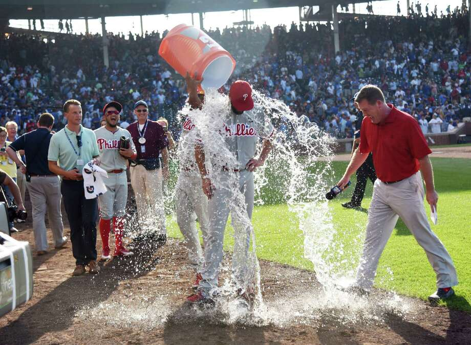 CHICAGO, IL - JULY 25:  Cole Hamels #35 of the Philadelphia Phillies gets a ice water bath after his no hitter on July 25, 2015 at Wrigley Field in Chicago, Illinois. Hamels pitched a no hitter and the Philliess won 5-0. (Photo by David Banks/Getty Images) ORG XMIT: 538587307 Photo: David Banks / 2015 Getty Images