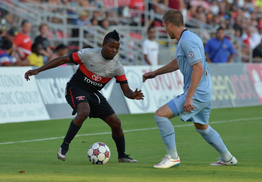 Scorpions Marvin Chavez gets around Minnesota's Justin Davis during the first half of their North American Soccer League game Saturday at Toyota Field. Photo: Robin Jerstad, Freelance / San Antonio Express-News