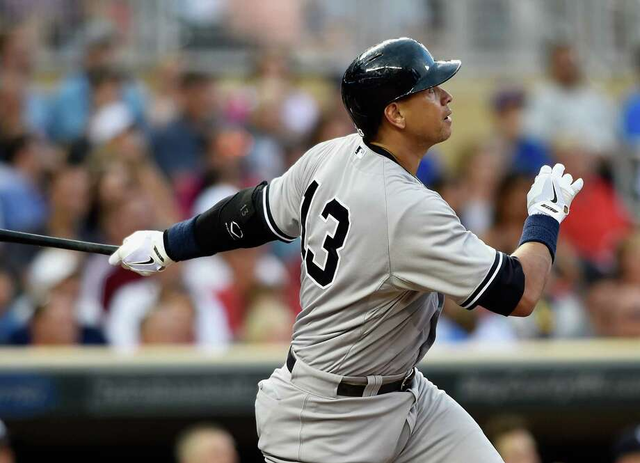 MINNEAPOLIS, MN - JULY 25: Alex Rodriguez #13 of the New York Yankees watches after hitting a two-run home run against the Minnesota Twins during the seventh inning of the game on July 25, 2015 at Target Field in Minneapolis, Minnesota. (Photo by Hannah Foslien/Getty Images) ORG XMIT: 538587293 Photo: Hannah Foslien / 2015 Getty Images