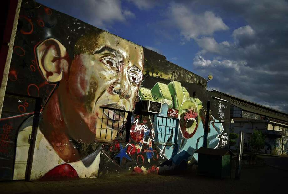 A graffito of President Barack Obama is near where Kenyans gathered in the city center to watch Obama's convoy as it drove through Nairobi. Obama is on a five-day East Africa state visit. In addition to visiting Kenya, he will visit Ethiopia. Photo: Carl De Souza /Getty Images / AFP