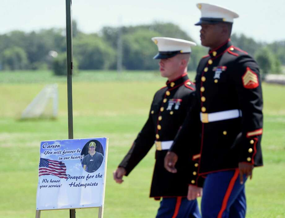 Two Marines arrive at the public visitation for Sgt. Carson Holmquist at Grantsburg High School in Grantsburg, Wis., Saturday, July 25, 2015. Holmquist was killed by a gunman in Chattanooga, Tenn. (AP Photo/Craig Lassig) Photo: Craig Lassig, FRE / Associated Press / FR52664 AP
