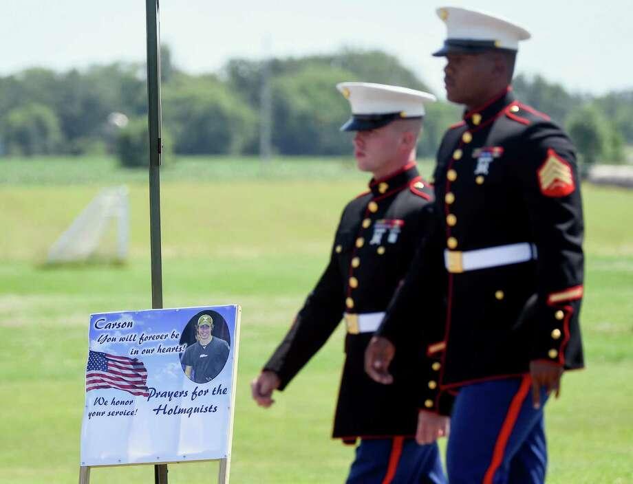 Two Marines arrive at the public visitation for Sgt. Carson Holmquist at Grantsburg High School in Grantsburg, Wis., Saturday, July 25, 2015. Holmquist was killed by a gunman in Chattanooga, Tenn. (AP Photo/Craig Lassig) Photo: Craig Lassig, FRE / Associated Press / FR52664 AP