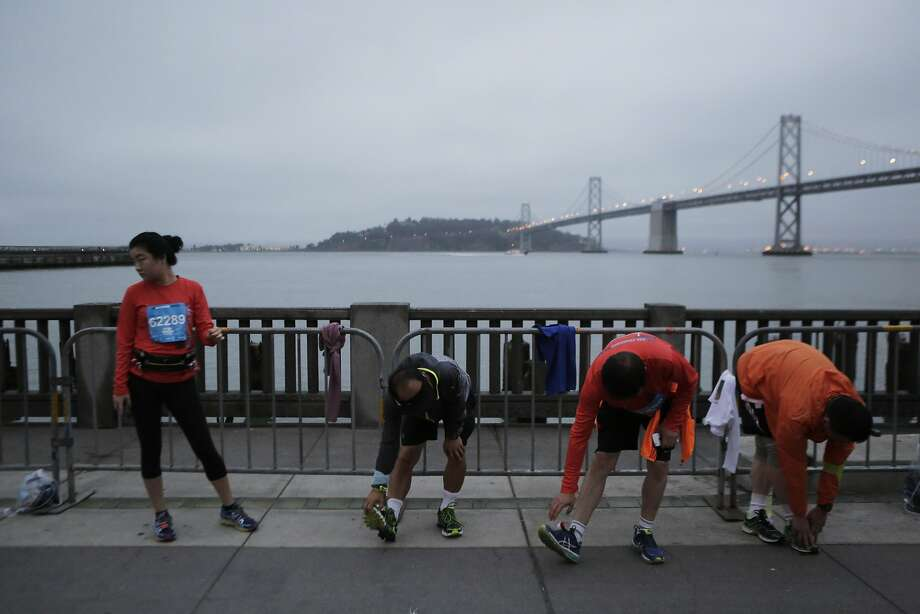 Participants stretch before starting the San Francisco Marathon on Sunday, July 26, 2015. Photo: Dorothy Edwards, The Chronicle