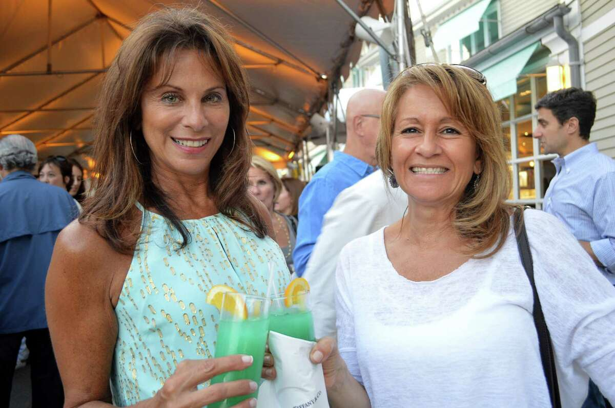 Cousins Diana Giampa of Fairfield and Lisa Epifano of Trumbull toast the Levitt Pavilion's gala before the Don Felder concert Saturday night.