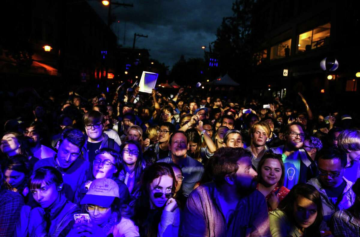 Fans watch Toro Y Moi perform on the main stage during day two of Capitol Hill Block Party. The three day festival brings music and tens of thousands of fans to the center of Seattle's Capitol Hill neighborhood. Photographed on Saturday, July 25, 2015.
