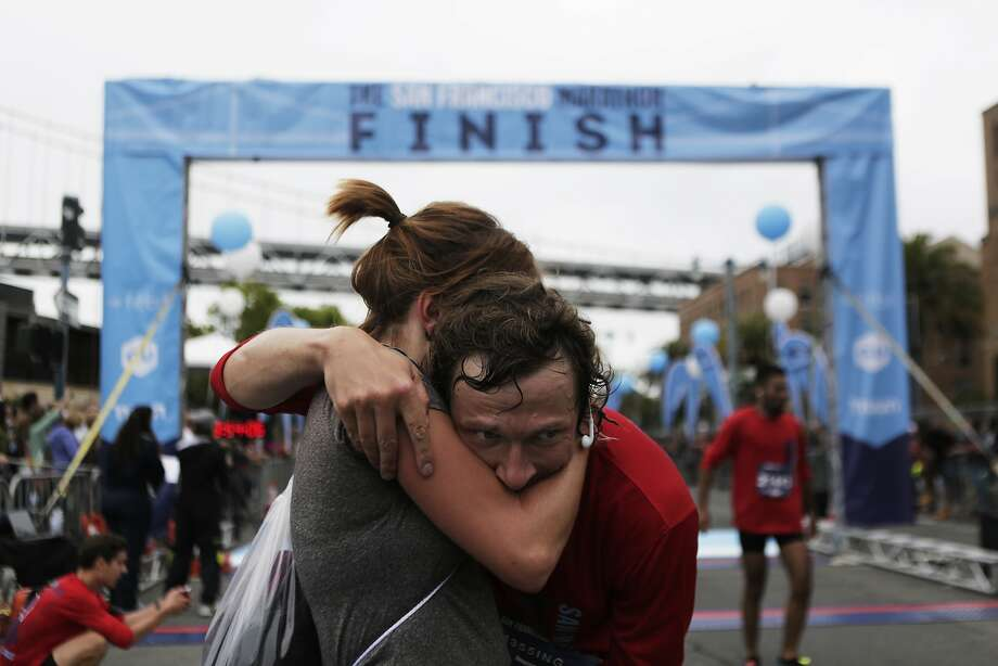 Carolin Dressler and Stefan Messing of Germany embrace each other after crossing the finish line together of the San Francisco Marathon on Sunday, July 26, 2015. Photo: Dorothy Edwards, The Chronicle
