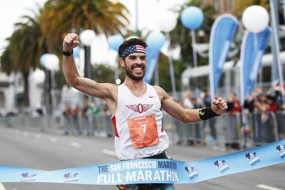 First place winner Chris Mocko crosses the finish line of the San Francisco Marathon on Sunday, July 26, 2015.
