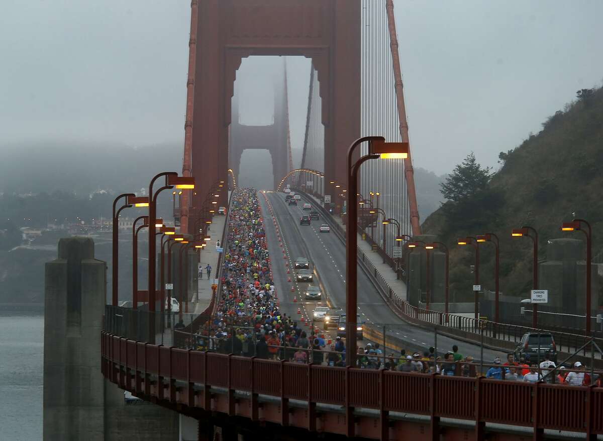 Thousands of runners ran across a wet and foggy Golden Gate Bridge during the annual San Francisco Marathon.