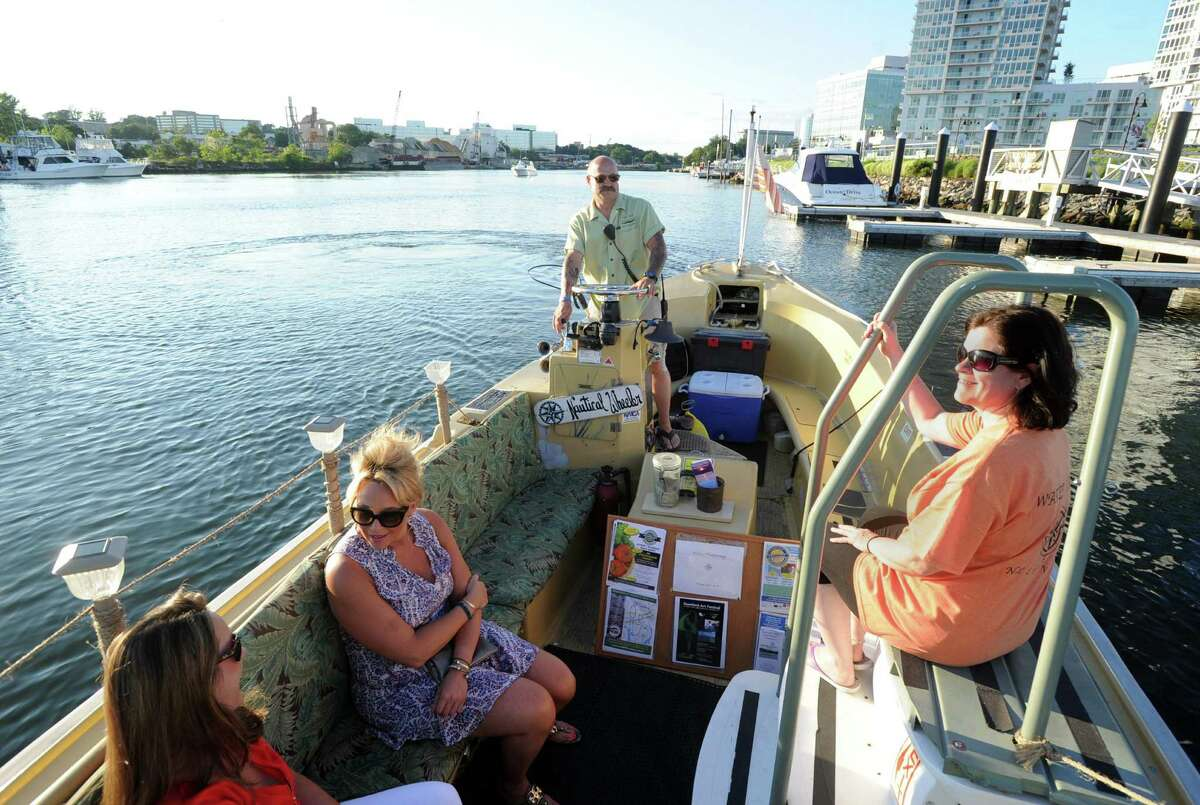 At top, Frank Fumega and his water taxi service that crosses a small section of water between Harbor Point and the Crab Shell restaurant, in Stamford, Conn., Thursday night, July 23, 2015.