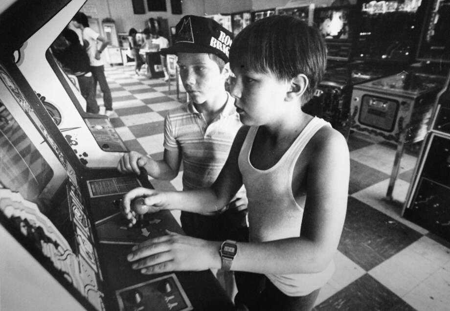 Larry Stamp, left, and Tom Toth play video games at Shoreside Fun Park in Cove Marina in Norwalk, in this undated file photo from The Advocate's archives. Photo: Advocate File Photo / Hearst Connecticut Media / Stamford Advocate