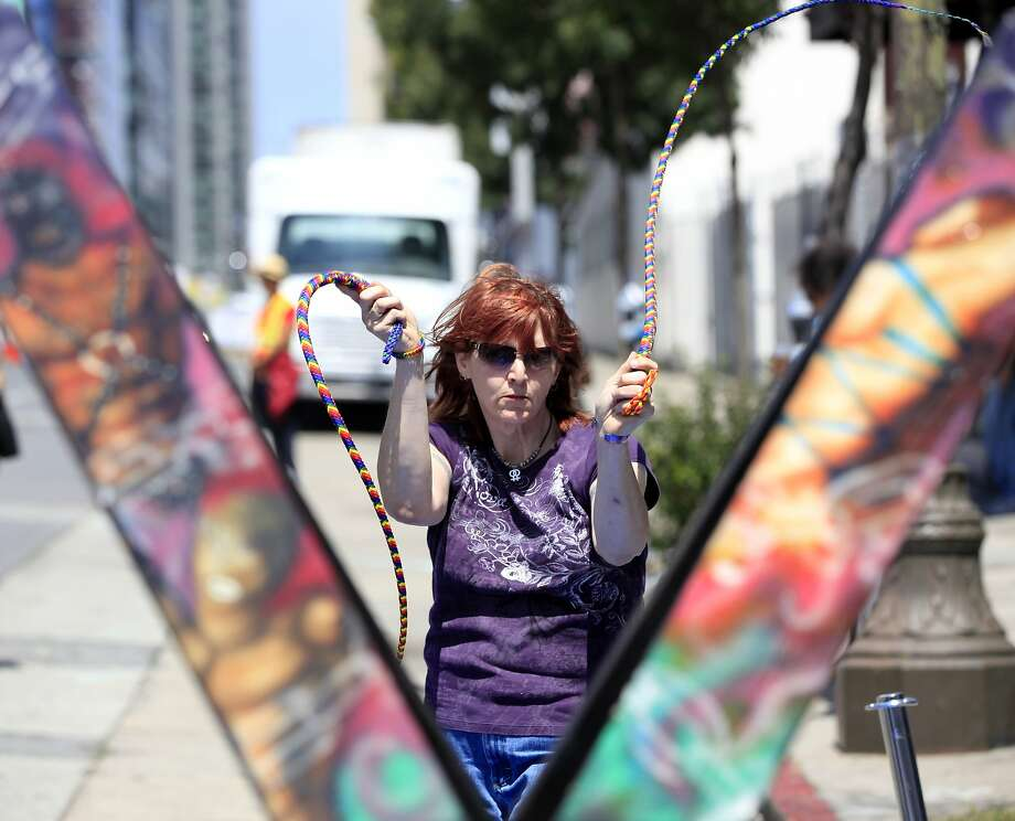 Nicole Harrington practices with whips at the Up Your Alley street fair in San Francisco, California, on Sunday, July 26, 2015. Photo: Connor Radnovich, The Chronicle