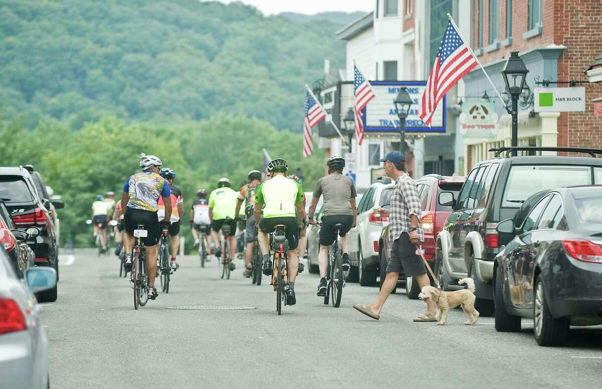 Cyclists head out from the New Milford Green to continue their cycling ride on Sunday.