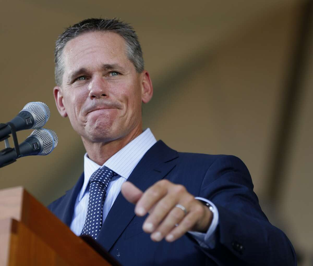 Craig Biggio waves to Matt Galante during the Hall of Fame induction ceremony on the grounds at Clark Sports Center on Sunday, July 26, 2015, in Cooperstown.