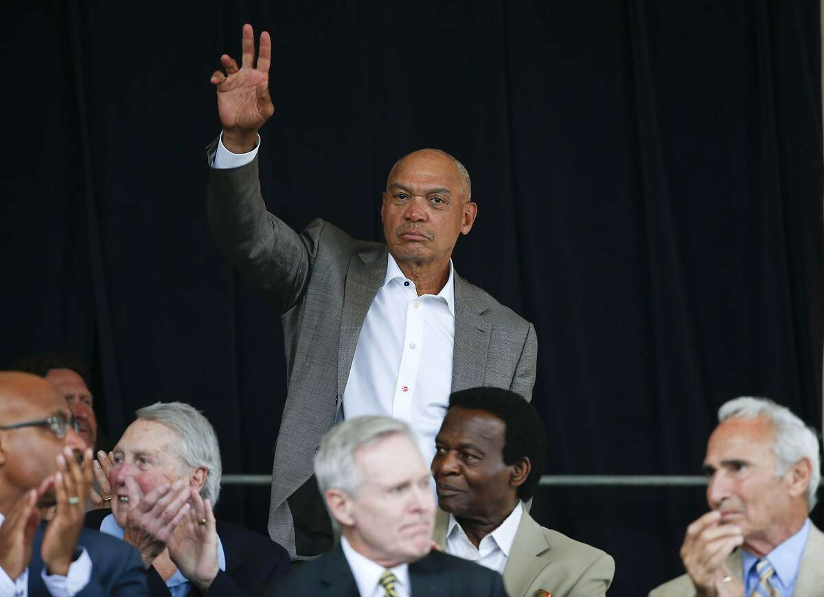National Baseball Hall of Famer Reggie Jackson is introduced during an awards ceremony at Doubleday Field on Saturday, July 25, 2015, in Cooperstown, N.Y. (AP Photo/Mike Groll)