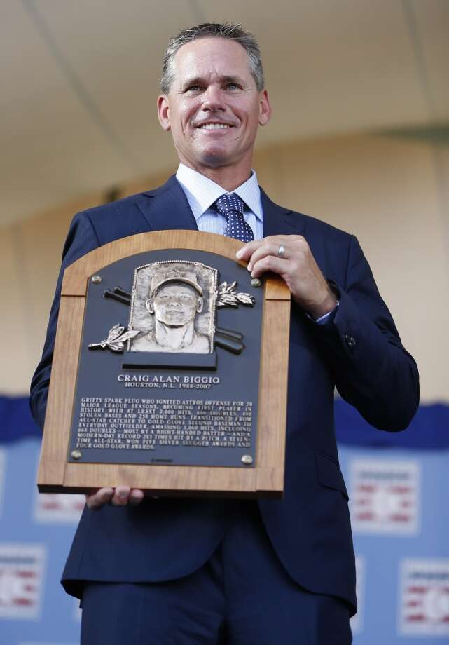 Craig Biggio holds his Hall of Fame plaque at the conclusion of the Hall of Fame induction ceremony on the grounds at Clark Sports Center on Sunday, July 26, 2015, in Cooperstown. ( Karen Warren / Houston Chronicle ) Photo: Houston Chronicle