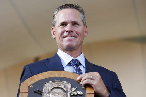 Craig Biggio holds his Hall of Fame plaque at the conclusion of the Hall of Fame induction ceremony on the grounds at Clark Sports Center on Sunday, July 26, 2015, in Cooperstown. ( Karen Warren / Houston Chronicle )
