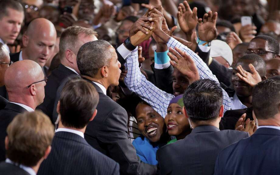 A Kenyan woman looks up at him as President Barack Obama reaches out to shake hands in the crowd as he departs after delivering a speech at the Safaricom Indoor Arena in Nairobi, Kenya. Photo: Ben Curtis /Associated Press / AP