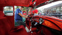 Phil De La Pena with Alamo City Rods looks inside his fully restored and customized1929 Ford Model A on display with other club member's cars at the Party on the Tower Plaza underneath the Tower of the Americas on Friday, July 10, 2015.  MARVIN PFEIFFER/ mpfeiffer@express-news.net