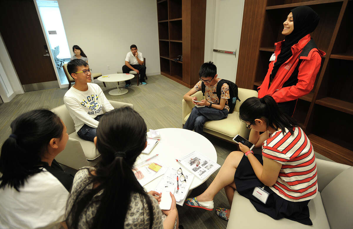 Masters in Education graduate student Hajira Butt, right, of Fairfield, instructs visiting students from China in the English Language Institute summer program at Sacred Heart University in Fairfield, Conn. on Tuesday, July 21, 2015.
