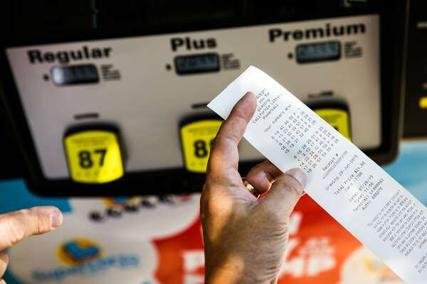 Lottery numbers print out on a California Lottery demonstration gas pump at the State Fair in Sacramento, California, July 26, 2015.