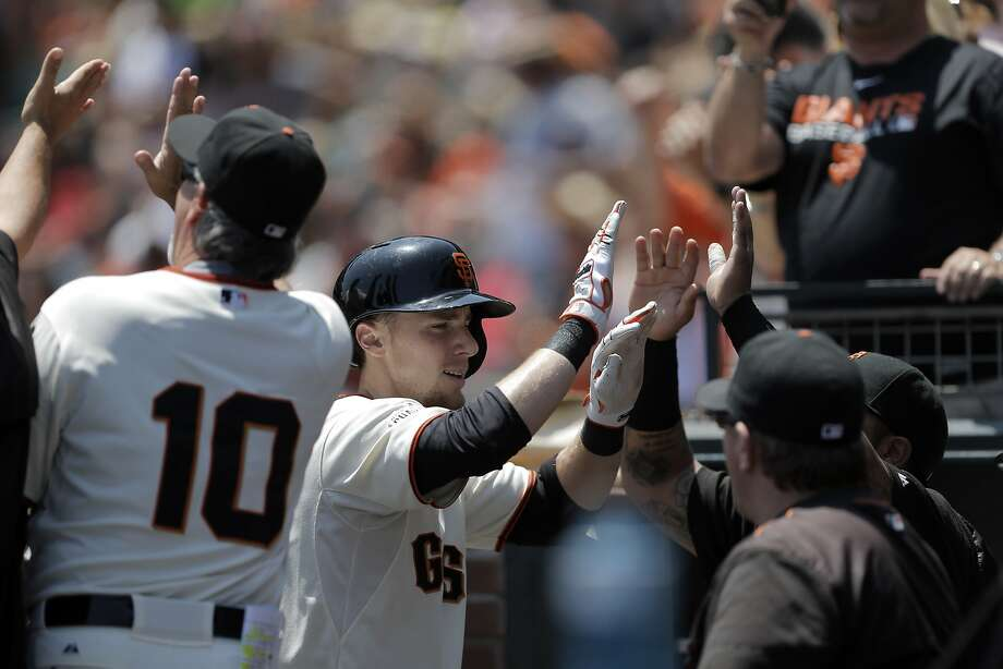 Matt Duffy (5) is congratulated by teammates in the dugout after hitting a two-run homerun in the first inning as the Giants played the Oakland Athletics at AT&T Park in San Francisco, Calif., on Sunday, July 26, 2015. The Giants won 4-3. Photo: Carlos Avila Gonzalez, The Chronicle