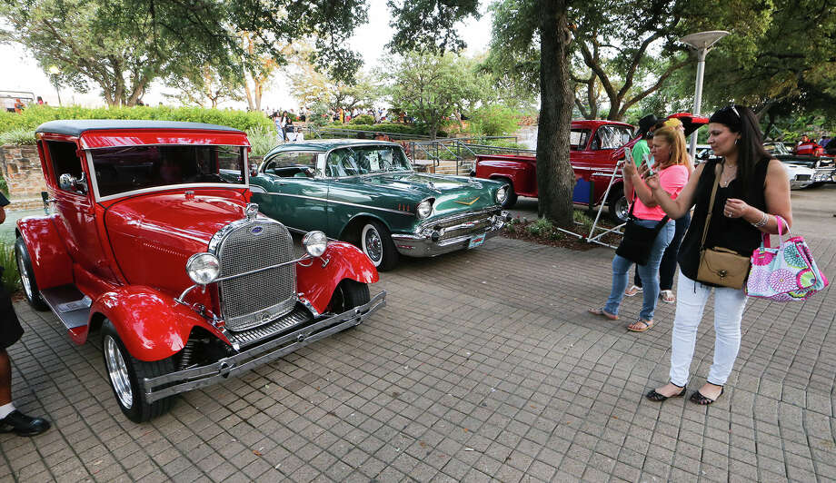 Vintage wheels belonging to members of the Alamo City Rods make for good photo ops at a recent Party on the Tower Plaza by the Tower of the Americas. The car club was established in 1974 with only a few members. Today, it has more than 100 members. Photo: Photos By Marvin Pfeiffer /San Antonio Express-News / Express-News 2015