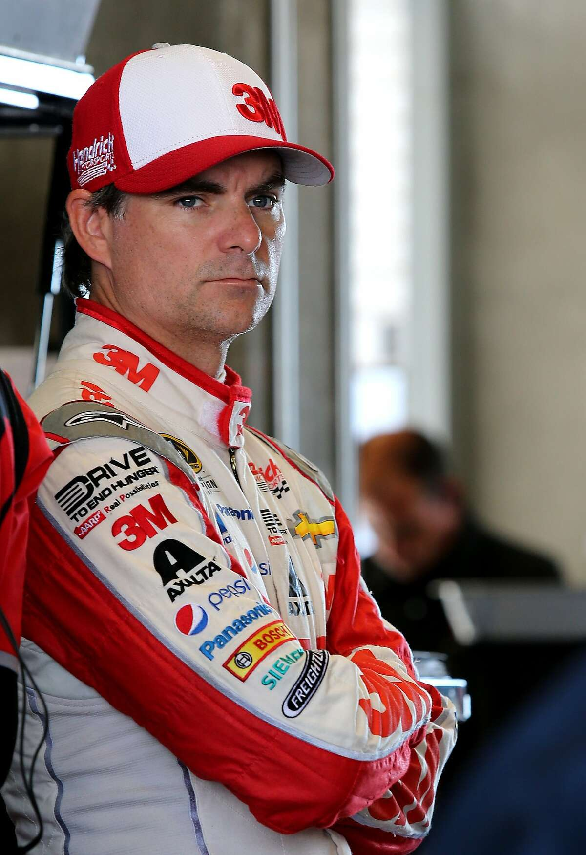 INDIANAPOLIS, IN - JULY 24: Jeff Gordon, driver of the #24 3M Chevrolet, stands in the garage area during practice for the NASCAR Sprint Cup Series Crown Royal Presents the Jeff Kyle 400 at the Brickyard at Indianapolis Motorspeedway on July 24, 2015 in Indianapolis, Indiana. (Photo by Jerry Markland/Getty Images)