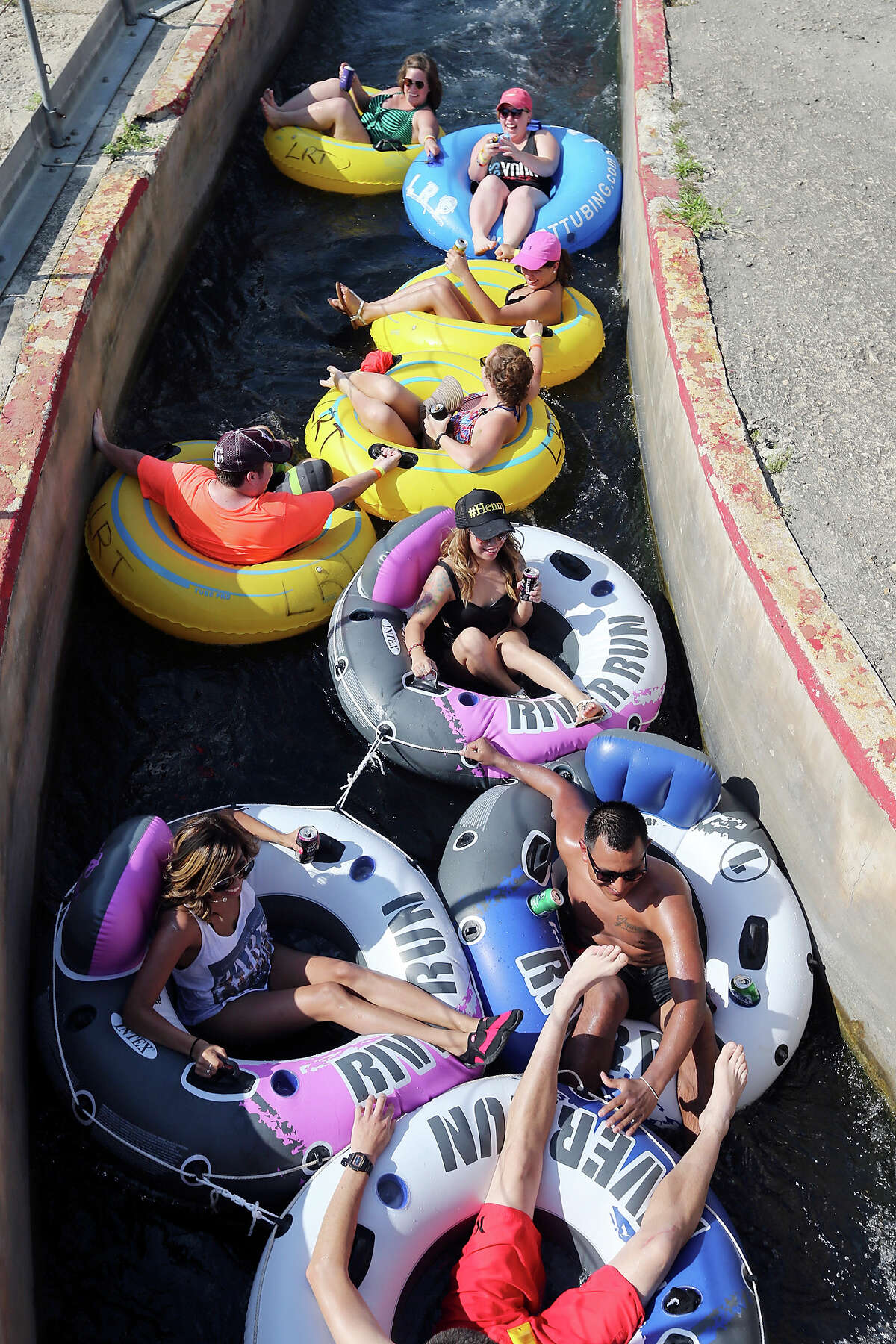 Trying to stay cool tubers enjoy the tube chute in Prince Solms Park on the Comal River Sunday July 26, 2015 in New Braunfels, Tx.
