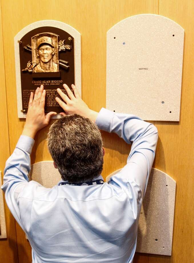 A Baseball Hall of Fame employee secures Craig Biggio's Hall of Fame plaque on it's spot in the museum, Sunday, July 25, 2015, in Cooperstown NY. (Karen Warren/Houston Chronicle)