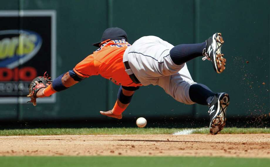 The Royals were adept at finding holes against Dallas Keuchel in a four-run first inning, including this grounder that just eluded Astros third baseman Luis Valbuena and turned into a two-run double for Cheslor Cuthbert. Photo: Colin E. Braley, FRE / FR123678 AP