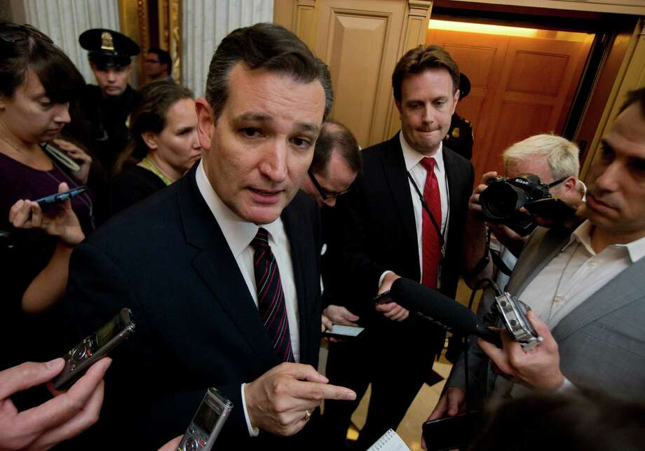 Sen. Ted Cruz, R-Texas, speaks to reporters following a rare Sunday Senate session on Capitol Hill in Washington, Sunday, July 26, 2015. Senior Senate Republicans lined up Sunday to rebuke Cruz for attacking Majority Leader Mitch McConnell, an extraordinary display of intraparty division played out live on the Senate floor. (AP Photo/Manuel Balce Ceneta) Photo: Manuel Balce Ceneta, STF / AP