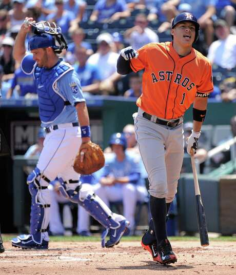 The Astros received a brief scare in the first inning when Carlos Correa was hit by a pitch from Yordano Ventura, but the rookie shortstop shook it off and stayed in the game. Photo: Ed Zurga, Stringer / 2015 Getty Images